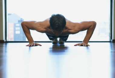 Man doing push-ups --- Image by © Oliver Eltinger/Corbis