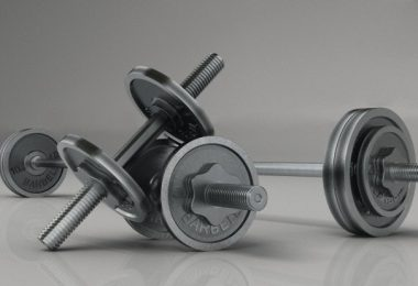 Barbells and dumbbells --- Image by © 3d4Medical.com/Corbis